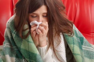 close-up-ill-teenager-with-tissue-her-nose
